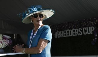 Connie Broge arrives for the Breeders' Cup horse races at Santa Anita Park, Friday, Nov. 1, 2019, in Arcadia, Calif. (AP Photo/Gregory Bull)