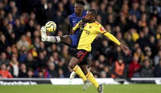 Chelsea's Tammy Abraham, left, and Watford's Christian Kabasele battle for the ball during the English Premiership League soccer match at Vicarage Road, Watford, England, Saturday Nov. 2, 2019. (John Walton/PA via AP)