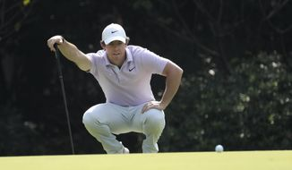 Rory McIlroy of Northern Ireland lines up his shot during day three of the HSBC Champions golf tournament held at the Sheshan International Golf Club in Shanghai on Saturday, Nov. 2, 2019. (AP Photo/Ng Han Guan)