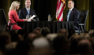 FILE - In this Tuesday, Oct. 29, 2019 file photo, Sheree Paolello of WLWT moderates the final gubernatorial debate between Democratic candidate Andy Beshear, center, and Gov. Matt Bevin in Highland Heights, Ky. (Albert Cesare/The Cincinnati Enquirer via AP, Pool)