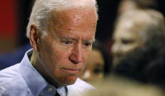 Democratic presidential candidate former Vice President Joe Biden talks with audience members during a town hall meeting, Thursday, Oct. 31, 2019, in Fort Dodge, Iowa. (AP Photo/Charlie Neibergall)