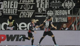 Frankfurt's Goncalo Paciencia, (39) celebrates after scoring his sides 5th goal of the game during the German Bundesliga soccer match between Eintracht Frankfurt and Bayern Munich in the Commerzbank Arena in Frankfurt, Germany, Saturday, Nov. 2, 2019. (AP Photo/Michael Probst)
