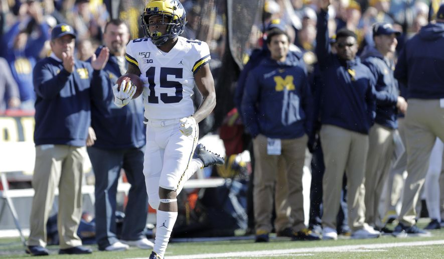 Michigan's Giles Jackson returns the opening kickoff for a touchdown during the first half of an NCAA college football game against Maryland, Saturday, Nov. 2, 2019, in College Park, Md. (AP Photo/Julio Cortez)