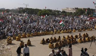 Supporters of Jamiat Ulema-e-Islam party listen to their leaders during an anti-government march and gather in Islamabad, Pakistan, Saturday, Nov. 2, 2019. Tens of thousands of Islamists remained in a protest camp in the heart of Pakistan's capital on Saturday amid tight security, as authorities deployed additional shipping containers and riot police to block access to key government buildings. (AP Photo/Anjum Naveed)