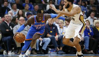 Oklahoma City's Dennis Schroder (17) drives the ball past New Orleans' Kenrich Williams (34) during the second half of an NBA basketball game in Oklahoma City, Saturday, Nov. 2, 2019. (AP Photo/Garett Fisbeck)