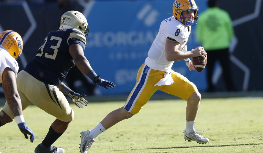 Pittsburgh quarterback Kenny Pickett (8) scrambles away from Georgia Tech defensive lineman T.K. Chimedza (93) as he looks for a an open receiver in the first half of an NCAA college football game Saturday, Nov. 2, 2019, in Atlanta. (AP Photo/John Bazemore)