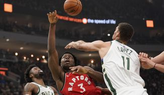 Toronto Raptors' OG Anunoby tries to shoot past Milwaukee Bucks' Brook Lopez during the first half of an NBA basketball game Saturday, Nov. 2, 2019, in Milwaukee. (AP Photo/Morry Gash)