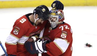 Florida Panthers center Brian Boyle (9) and goaltender Sergei Bobrovsky (72) embrace after the team's NHL hockey game against the Detroit Red Wings, Saturday, Nov. 2, 2019, in Sunrise, Fla. The Panthers won 4-0. (AP Photo/Lynne Sladky)