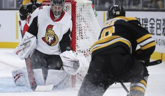 Ottawa Senators goaltender Craig Anderson makes a save on a shot by Boston Bruins left wing Anders Bjork, right, during the second period of an NHL hockey game in Boston, Saturday, Nov. 2, 2019. (AP Photo/Charles Krupa)