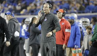 Memphis head coach Mike Norvell watches from the sideline in the first half of an NCAA college football game against SMU Saturday, Nov. 2, 2019, in Memphis, Tenn. (AP Photo/Mark Humphrey)