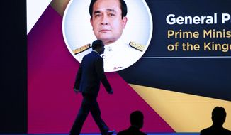Thailand Prime Minister Prayuth Chan-ocha walks onto the stage to deliver an opening speech during the ASEAN Business and Investment Summit (ABIS) Nonthaburi, Thailand, Saturday, Nov. 2, 2019. (AP Photo/Wason Wanichakorn)