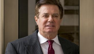 FILE - In this April 4, 2018, file photo, Paul Manafort, President Donald Trump's former campaign chairman, leaves the federal courthouse in Washington. Newly released documents show a Trump campaign official told the FBI that during the 2016 presidential race the campaign's chairman, Manafort, pushed the idea that Ukraine, not Russia, was behind the hack of the Democratic National Committee's servers. (AP Photo/Andrew Harnik, File)