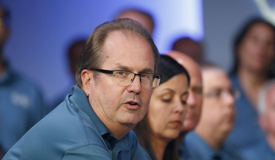 In this July 16, 2019, file photo, Gary Jones, United Auto Workers president, speaks during the opening of their contract talks with Fiat Chrysler Automobiles in Auburn Hills, Mich. Jones is taking a paid leave of absence amid a federal investigation of corruption in the union. The UAW said Jones requested the leave, which is effective Sunday, Nov. 3. The federal government has been investigating fraud and misuse of funds at the UAW for more than two years. (AP Photo/Paul Sancya, File)