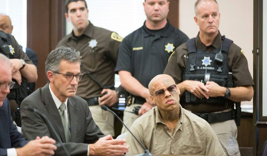 Nikko Jenkins (front right) who was convicted of killing four people in and around Omaha, Nebraska, in 2013, was sentenced to death by a three-judge panel in 2017. Jenkins wants the Supreme Court to review his sentence. (Associated Press)