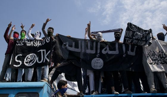 Kashmiri protesters hold Islamic State flags as they shout slogans during a protest in Srinagar, Indian controlled Kashmir, Friday, May 31, 2019. Government forces in Indian controlled Kashmir fired tear gas and pellets to disperse hundreds of protesters who clashed with them during a protest against the recent killing of Kashmir rebel leader and also an annual protest marking Al-Quds Day. The last Friday of the Islamic holy month of Ramadan is observed in many Muslim communities as Al-Quds Day, or Jerusalem Day, as a way of expressing support to the Palestinians and emphasizing the importance of Jerusalem to Muslims. (AP Photo/Dar Yasin)