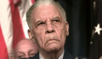 "In this Dec. 9, 1998 file photo, Ret. Lt. Gen. Benjamin O. Davis Jr., listens to remarks prior to receiving his fourth star from President Clinton at the Old Executive Office Building in Washington. Davis Jr. entered West Point in 1932 as its only black cadet and spent the next four years shunned. He roomed alone and ate alone. The future Tuskegee Airman and trailblazing Air Force general later recalled he was ""an invisible man.""  Now more than a decade after his death, the academy that ostracized Davis is honoring him.  (AP Photo/Greg Gibson, File)"