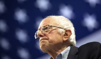 Sen. Bernie Sanders gazes at the crowd during a rally with Rep. Ilhan Omar inside of Williams Arena in Minneapolis on Sunday, Nov. 3, 2019. (Evan Frost/Minnesota Public Radio via AP)
