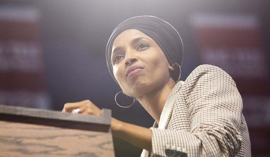Rep. Ilhan Omar introduces Sen. Bernie Sanders during a rally inside of Williams Arena in Minneapolis on Sunday, Nov. 3, 2019. (Evan Frost/Minnesota Public Radio via AP)
