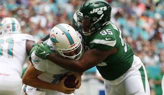 New York Jets defensive tackle Quinnen Williams (95) sacks Miami Dolphins quarterback Ryan Fitzpatrick (14) during the first half of an NFL football game, Sunday, Nov. 3, 2019, in Miami Gardens, Fla. (AP Photo/Wilfredo Lee) ** FILE **