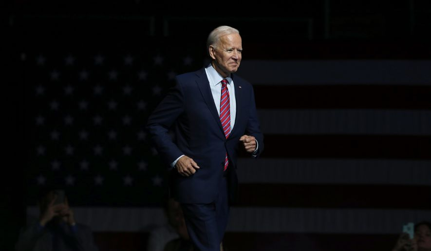 FILE - In this Friday, Nov. 1, 2019, file photo, Democratic presidential candidate former Vice President Joe Biden walks on stage to speak at the Iowa Democratic Party's Liberty and Justice Celebration, in Des Moines, Iowa. Biden is working on a national campaign of his own, but he made time for a trip to Virginia, Sunday, Nov. 3, to rally party activists two days before a pivotal state election. (AP Photo/Nati Harnik, File)