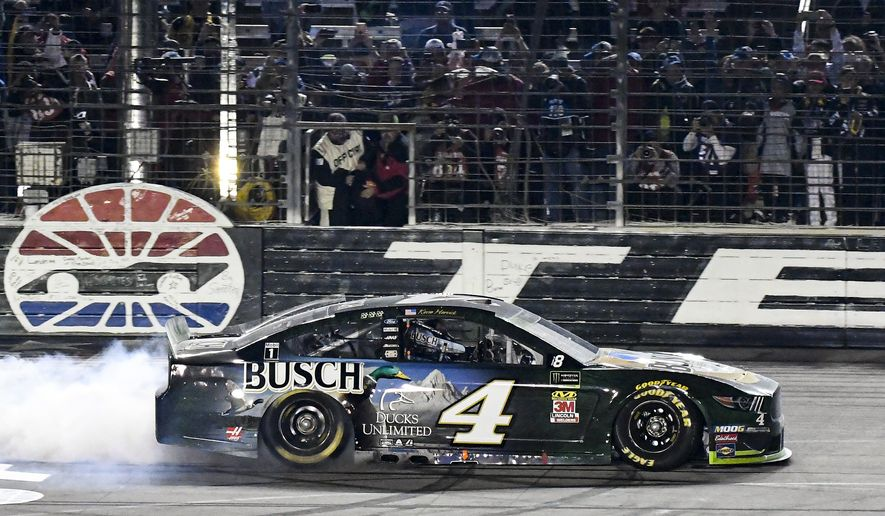 Kevin Harvick (4) celebrates winning a NASCAR Cup Series auto race with a burnout at Texas Motor Speedway, Sunday, Nov. 3, 2019, in Fort Worth, Texas. (AP Photo/Randy Holt)
