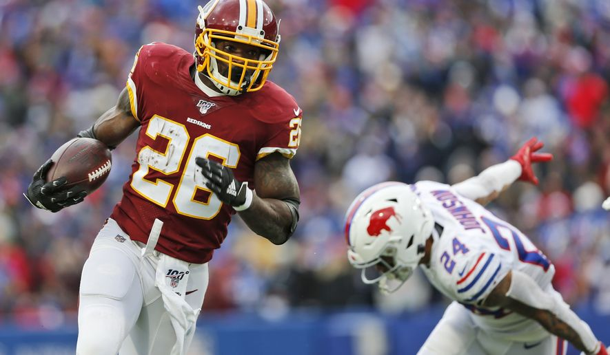 Washington Redskins running back Adrian Peterson (26) rushes against Buffalo Bills cornerback Taron Johnson (24) during the first half of an NFL football game, Sunday, Nov. 3, 2019, in Orchard Park, N.Y. (AP Photo/John Munson) ** FILE **