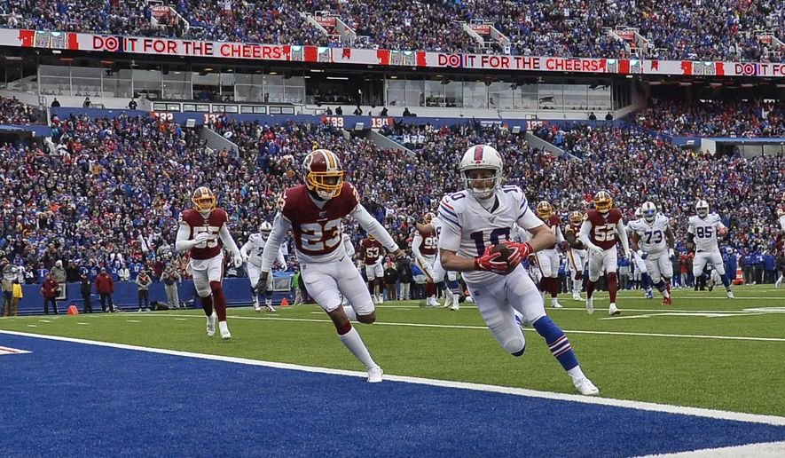 Buffalo Bills wide receiver Cole Beasley (10) scores a 6-yard touchdown against Washington Redskins cornerback Quinton Dunbar (23) during the first half of an NFL football game, Sunday, Nov. 3, 2019, in Orchard Park, N.Y. (AP Photo/Adrian Kraus)