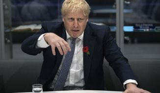 Britain's Prime Minister Boris Johnson gestures, during a visit to Metropolitan Police training college in Hendon, north London, Thursday, Oct. 31, 2019. (Aaron Chown/Pool Photo via AP)