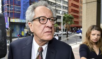 Actor Geoffrey Rush arrives at the Federal Court in Sydney, Monday, Nov. 4, 2019. Nationwide News is appealing a Federal Court judge's ruling that the 68-year-old Australian actor had been defamed by newspaper reports that he had been accused of inappropriate behavior by an actress. (Joel Carrett/AAP Image via AP)