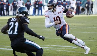 Chicago Bears' Mitchell Trubisky, right, tries to scramble past Philadelphia Eagles' Ronald Darby during the second half of an NFL football game, Sunday, Nov. 3, 2019, in Philadelphia. (AP Photo/Chris Szagola)  **FILE**