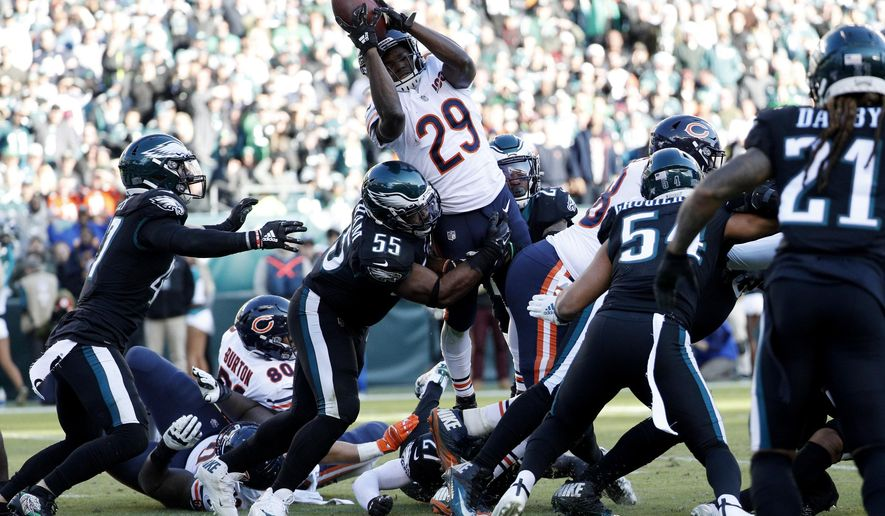 Chicago Bears' Tarik Cohen (29) cannot make it into the end zone against Philadelphia Eagles' Brandon Graham (55) during the second half of an NFL football game, Sunday, Nov. 3, 2019, in Philadelphia. (AP Photo/Chris Szagola)