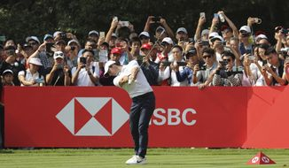 Rory McIlroy of Northern Ireland tees off on the final day of the HSBC Champions golf tournament at the Sheshan International Golf Club in Shanghai on Sunday, Nov. 3, 2019. (AP Photo/Ng Han Guan)