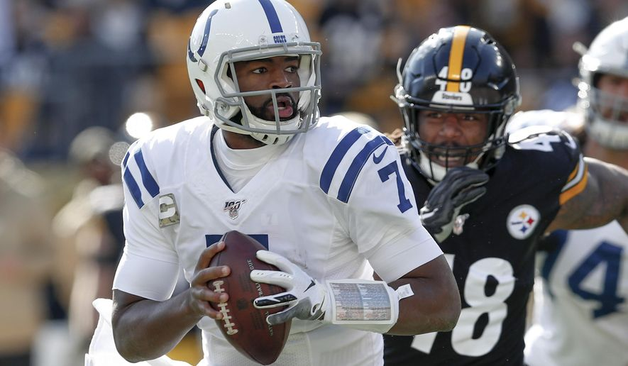 Indianapolis Colts quarterback Jacoby Brissett (7) scrambles away from Pittsburgh Steelers outside linebacker Bud Dupree (48) before being sacked in the first half of an NFL football game, Sunday, Nov. 3, 2019, in Pittsburgh. (AP Photo/Don Wright)