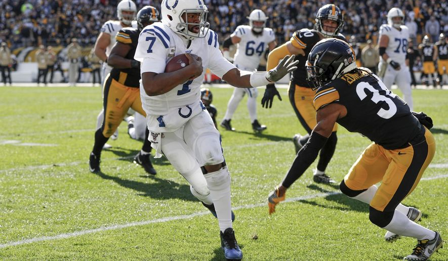 Indianapolis Colts quarterback Jacoby Brissett (7) scrambles away from Pittsburgh Steelers strong safety Terrell Edmunds (34) in the first half of an NFL football game , Sunday, Nov. 3, 2019, in Pittsburgh. (AP Photo/Don Wright)