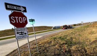 Vehicles travel U.S. Highway 20 in eastern Woodbury County west of Correctionville, Iowa, Tuesday, Oct. 22, 2019. It has been a year since the final sections of the highway in western Iowa have been upgraded to four-lanes.  (Tim Hynds/Sioux City Journal via AP)