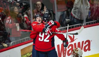 Washington Capitals left wing Jakub Vrana (13), of the Czech Republic, celebrates with center Evgeny Kuznetsov (92), of Russia, after scoring during the first period of an NHL hockey game Sunday, Nov. 3, 2019, in Washington. (AP Photo/Al Drago)