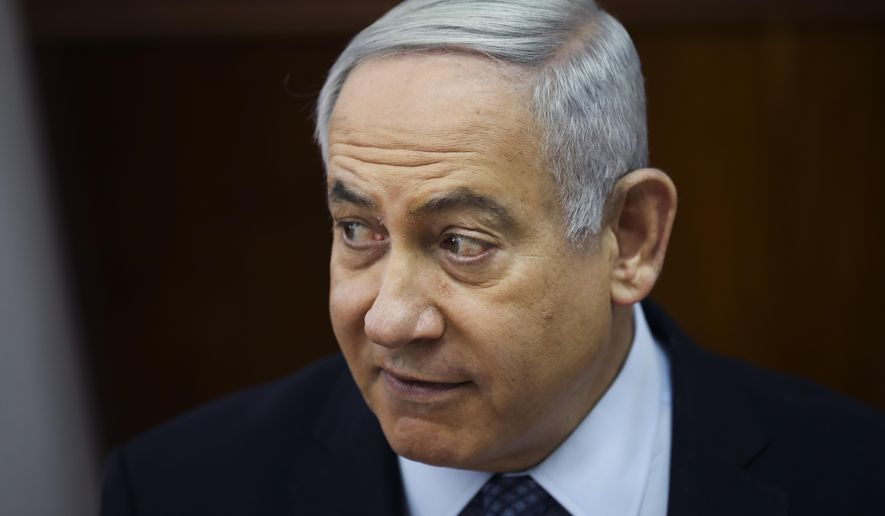 Israeli Prime Minister Benjamin Netanyahu, chairs the weekly cabinet meeting at the Prime Minister's office in Jerusalem, Sunday, Nov. 3, 2019. (AP Photo/Oded Balilty, pool)