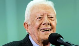 FILE - In this Sept. 18, 2019 file photo, former President Jimmy Carter listens to a question submitted by a student during an annual Carter Town Hall held at Emory University in Atlanta.  Carter is back at church teaching Sunday school less than two weeks after breaking his pelvis in a fall. The 95-year-old Democrat used a walker to slowly enter the crowded sanctuary at Maranatha Baptist Church in the southwest Georgia town of Plains on Sunday, Nov. 3. (AP Photo/John Amis, File)