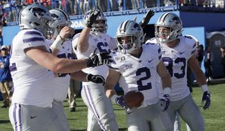 Kansas State running back Harry Trotter (2) celebrates a touchdown with teammates during the first half of an NCAA college football game against Kansas in Lawrence, Kan., Saturday, Nov. 2, 2019. (AP Photo/Orlin Wagner)