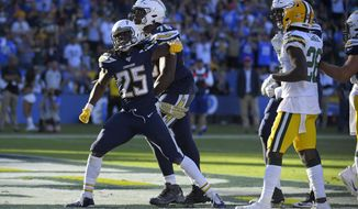 Los Angeles Chargers running back Melvin Gordon celebrates after scoring during the second half of an NFL football game against the Green Bay Packers Sunday, Nov. 3, 2019, in Carson, Calif. (AP Photo/Mark J. Terrill)