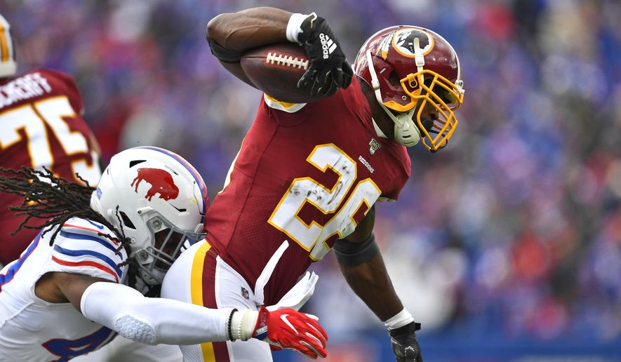 Washington Redskins running back Adrian Peterson (26) is tackled by Buffalo Bills middle linebacker Tremaine Edmunds (49) during the first half of an NFL football game, Sunday, Nov. 3, 2019, in Orchard Park, N.Y. (AP Photo/Adrian Kraus) ** FILE **