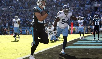 Carolina Panthers running back Christian McCaffrey (22) scores a touchdowmn while Tennessee Titans inside linebacker Rashaan Evans (54) chases during the first half of an NFL football game in Charlotte, N.C., Sunday, Nov. 3, 2019. (AP Photo/Brian Blanco)