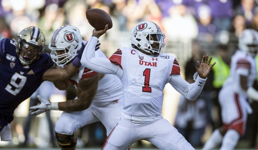 Utah quarterback Tyler Huntley passes during the second half of an NCAA college football game against Washington, Saturday, Nov. 2, 2019 in Seattle. Utah won 33-28. (AP Photo/Stephen Brashear)