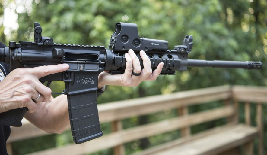 In this June 24, 2016, file photo, an AR-15 is held in Auburn, Ga. (Associated Press) ** FILE **