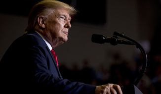President Donald Trump pauses while speaking at a rally at BancorpSouth Arena in Tupelo, Miss., Friday, Nov. 1, 2019. (AP Photo/Andrew Harnik)