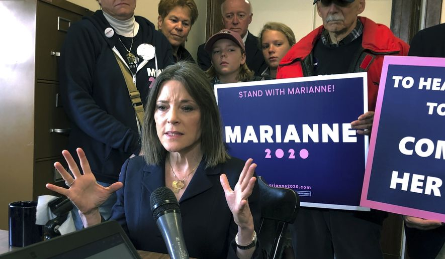 Democratic presidential candidate author Marianne Williamson speaks to the media after she filed to be listed on the ballot for the New Hampshire primary, Monday, Nov. 4, 2019, in Concord, N.H. (AP Photo/Holly Ramer)