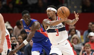 Washington Wizards guard Bradley Beal (3) reaches for the ball in front of Detroit Pistons forward Tony Snell (17) during the first half of an NBA basketball game, Monday, Nov. 4, 2019, in Washington. (AP Photo/Nick Wass)