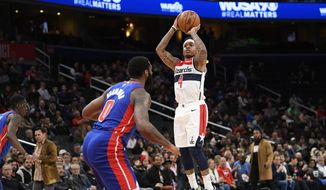 Washington Wizards guard Isaiah Thomas (4) shoots in front of Detroit Pistons center Andre Drummond (0) during the second half of an NBA basketball game, Monday, Nov. 4, 2019, in Washington. (AP Photo/Nick Wass) **FILE**
