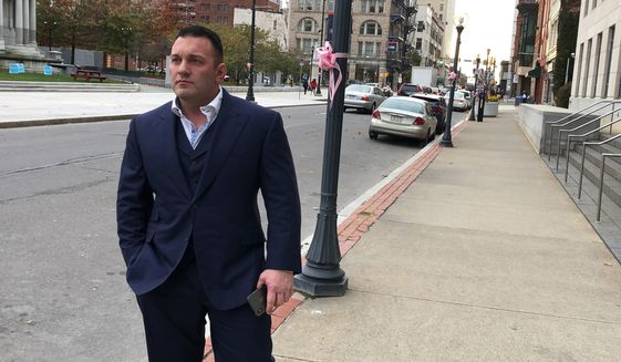 Perry Santillo walks outside the federal courthouse in Scranton, Pa., Monday, Nov. 4, 2019, after pleading guilty to a federal fraud charge. Prosecutors say Santillo masterminded a Ponzi scheme that took in more than $115 million from investors around the country. (AP Photo/Michael Rubinkam)