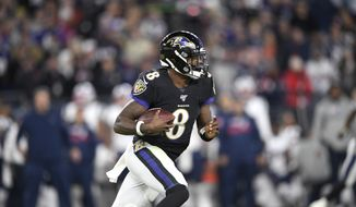 Baltimore Ravens quarterback Lamar Jackson runs with the ball against the New England Patriots during the first half of an NFL football game, Sunday, Nov. 3, 2019, in Baltimore. (AP Photo/Nick Wass)